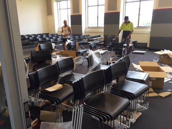 Set up of 300 student tablet arm chairs for temporary classrooms
